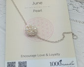 Snowball with silver chain necklace