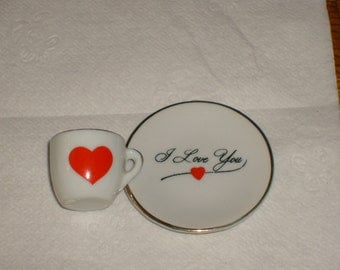 "Miniature cup and saucer that says  ""I love you""  Adorable knick knack"