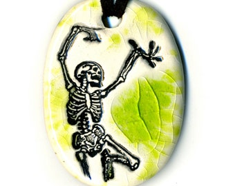 Dancing Skeleton Ceramic Necklace in Green Crackle