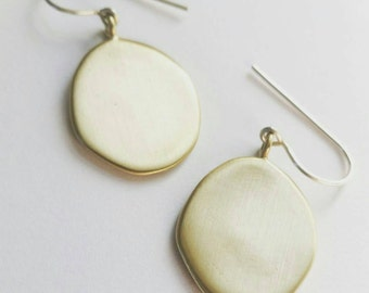 Minimalist Gold Drop Amulet Earrings. Brushed Drop Coin Earrings. Sterling Silver or Brushed Brass Amulet Earrings. Statement Earrings.