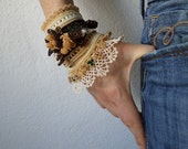 beaded crochet bracelet with cream, brown, green and beige beaded details, crocheted flowers and laces
