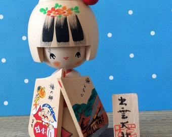 Cute kokeshi souvenir from Izumo Taisho Shrine - good luck matchmaking doll with Daikoku