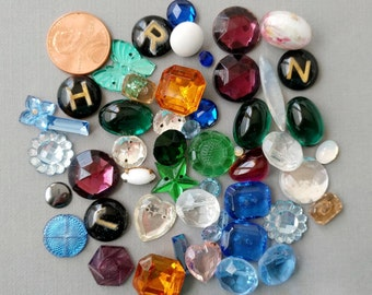 Lot of vintage cabochons, sew ons and some buttons.