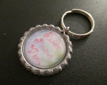 ONE 'Radiate Positive Vibes' Bottle Cap Charm Keychain
