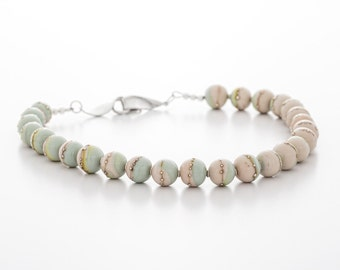 lampwork necklace with silver, mint green and pinkish cream, artisan glass jewelry