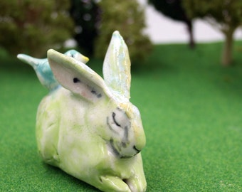 rabbit figurine -  green bunny with bird - porcelain sculpture