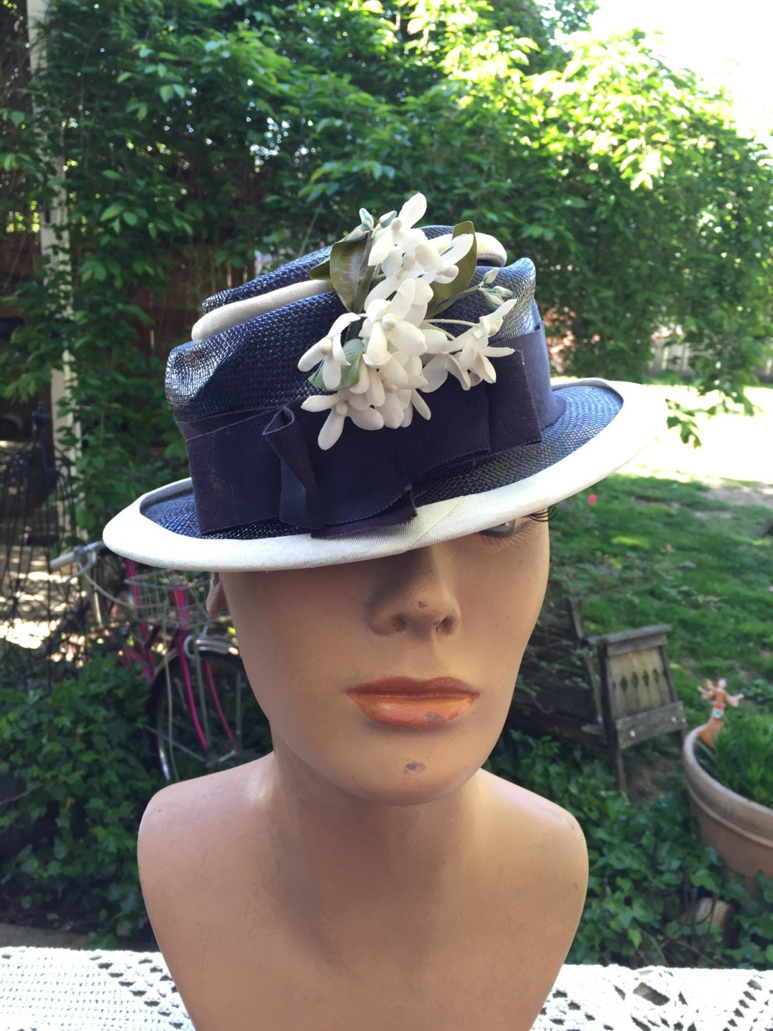 vintage ladies blue and white hat with white millinery