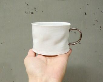 Silver handle porcelain crumple cup