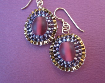 red Czech glass with purple and bronze seed bead stitched earrings