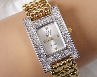 Vintage Elizabeth Taylor Rectangular Watch Like New Condition. Clear Protective Plastic is Still on Back. Rhinestone Accents Goldtone (D4)