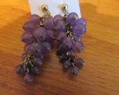 Purple grape cluster post