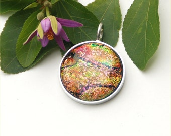 Fused dichroic glass pendant in silver plated setting, round, red, pink, gold, green