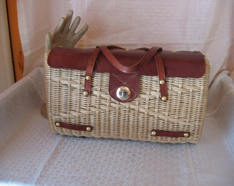 Natural Plastic Wicker Purse with Brown Leather Handles and Leather and Brass Accents