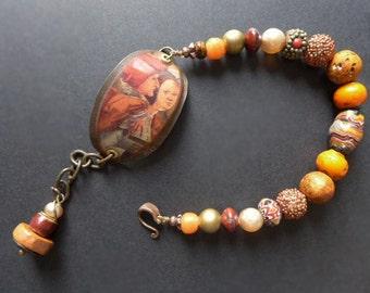Bloom of Youth. Rustic assemblage bracelet in earthy orange brown.