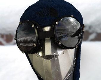 black snowboarding ski goggles, bug eyed oversized lenses, military troups quality