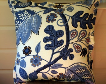 Beautiful blue and white upholstery fabric cushion with hand embroidered detail