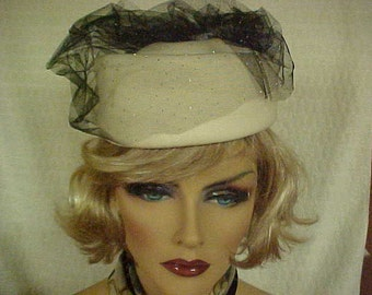 White  wool pill box hat with black sparkly netting on top  - fits 22""