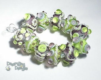 GARDEN PARTY Lampwork Beads Handmade Green Purple Clear Silver  Bold and Textured  Set of 11