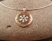 Brass and Sterling Snowflake Pendant