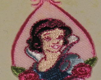 CLEARANCE * Disney's Snow White applique is a cute embroidered motif * new in package