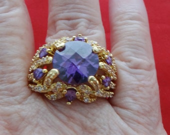 20% off sale Vintage new old stock NOS size 10 gold tone ring with art deco styling and purple rhinestones in unworn condition, top of ring