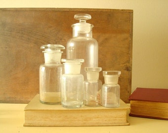 Antique apothecary jars, 5 clear glass bottle, ground glass stoppers, authentic 1900s pharmacy bottles, Pyrex, scientific collectibles