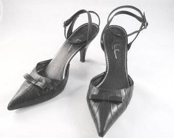 CLOSING SALE Vintage Nicole Miller strappy black leather high heel pumps. Size 7 1/2 M. Ankle straps. Pointy toes.