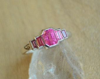 Five Stone Baguette Ring in 14 kt White Gold with Neon Mahenge Spinel and Burmese Spinel