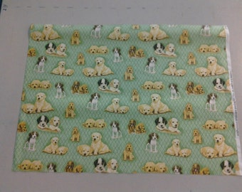 fabric with cute puppies on green 247676