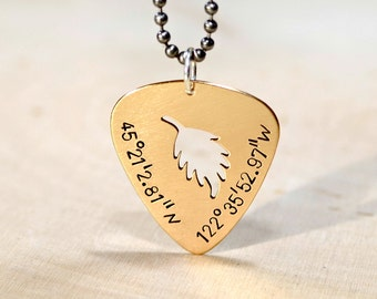 Custom cut out guitar pick necklace in bronze shown here with latitude longitude coordinates - NL479