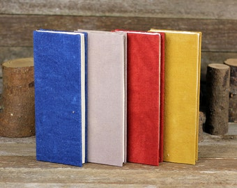 naturally dyed tall and thin hand-bound journals:  by kata golda