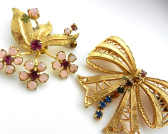 European antique brooches, two feminine pins in gold tone and brilliant stones - bouquet of  iridescent flowers and graceful bow - Art.493/4