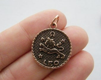 2 Leo pendants antique copper tone