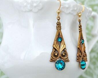 PETITE ART DECO,  antiqued brass art deco style earrings with blue zircon glass rhinestones