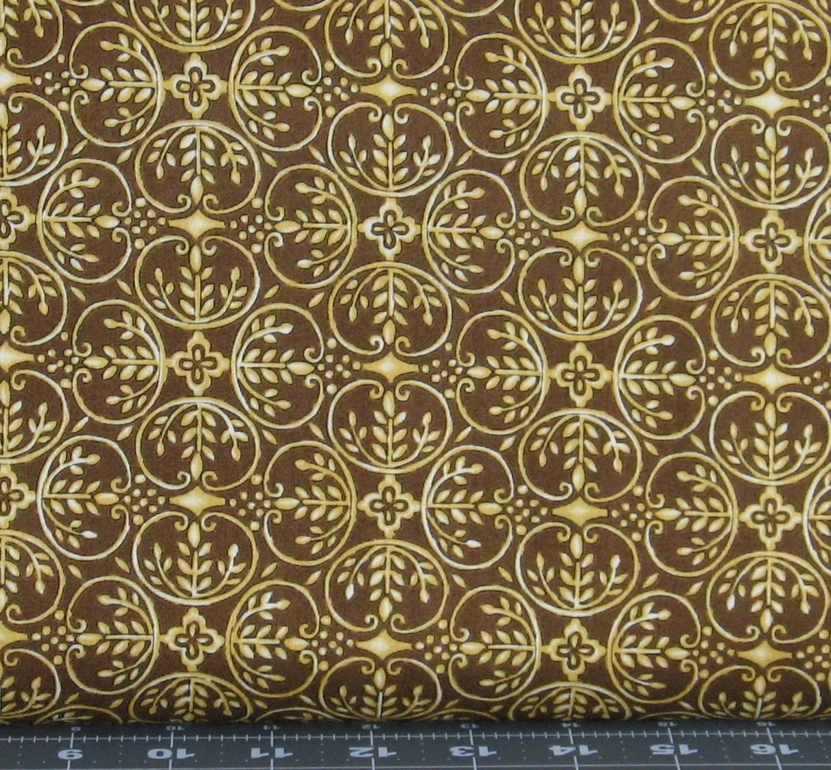 Gold design on brown cotton quilt fabric for sale for Quilting fabric sale