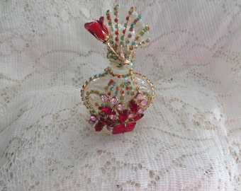 Jeweled perfume bottle, in multicolored jewels, with stopper,  altered, 6 inch