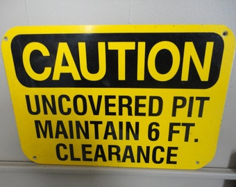 Caution Sign - Pit