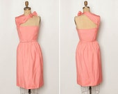 vintage 1960s asymmetrical cut out cocktail dress with bow