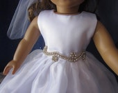 communion dress with rhinestone trim will fit 18 inch dolls such as American Girl