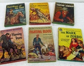 Six Vintage Retro Kitsch Western Cowboy Indians Paperback Novels 1950 s Mark of Zorro Gold Passage Flaming Irons Free Shipping