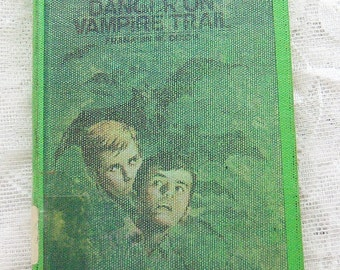 The Hardy Boys No 50 Danger on Vapire Trail written by Franklin W. Dixon, copyright 1971, vintage Hardy Boys Mystery book 516