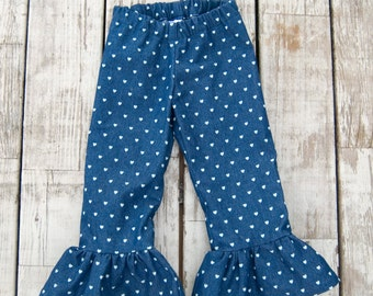 Girls denim ruffle pants with heart pattern