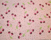 Cotton Fabric With Chocolate Covered Cherries on a Peachy Pink and Polka Dot Background