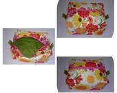 Floral boxy pouch with green liner and tabs, sock knitting,