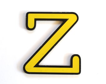 Vintage Yellow and Black Plastic Sign Letter Z