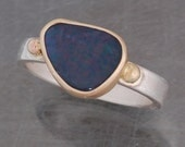 Boulder opal ring in sterling silver and 14 karat gold