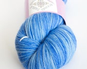 Light blue fingering weight hand-dyed yarn   Round Table Yarns Perceval in Quest colorway