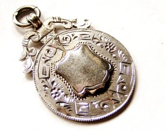 Vintage sterling silver heavy  watch fob, hand engraved round medal
