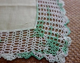 Very light green hankie with variegated greens in crocheted edge detail