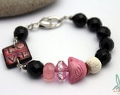 Reserved for Kathleen = Love, bracelet in pink and black with handmade ceramic bird and urchin bead and art tile